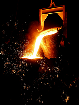 Pouring molten metal while casting iron