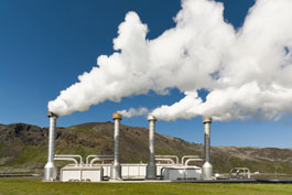 A geothermal power plant emitting steam.
