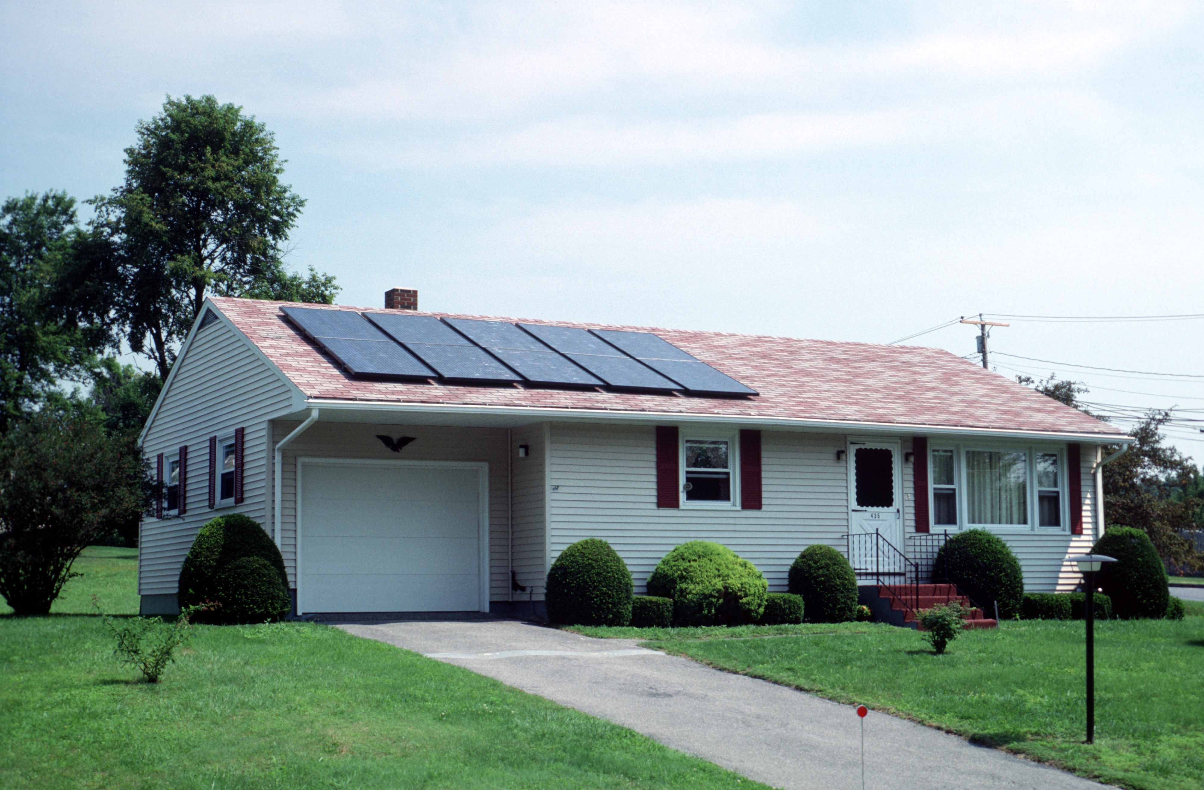 Image of a solar photovoltaic system on the roof of a house.